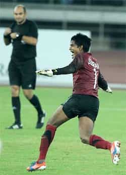 Indian goalkeeper Subrata Paul (1) celebrates after win over Cameroon in tie-breaker by 7-6 during Nehru cup final match in New Delhi. (PTI Photo by Vijay Verma) India lift Nehru Cup