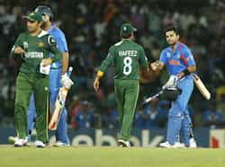 Virat Kohli, right, shakes hands with Mohammad Hafeez after beating them by 8 wickets in the ICC Twenty20 Cricket World Cup Super Eight match between India and Pakistan in Colombo. (AP Photo/Eranga Jayawardena) WC T20: India beat Pak