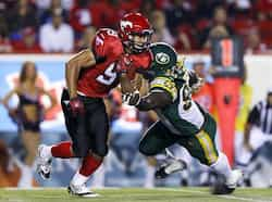 Calgary Stampeders Jon Cornish (L) gets past Edmonton Eskimos Almondo Sewell during the first half of their CFL football game in Calgary, Alberta. Reuters Photo Sept 29: day in pics