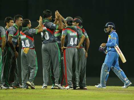 Afghanistan teammates celebrate the wicket of Virender Sehwag, right, during their ICC Twenty20 Cricket World Cup match in Colombo, Sri Lanka. AP/Eranga Jayawardena WC T20: India beat Afghanistan