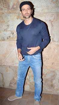 Cool dude Hrithik Roshan is plugged in while poses for the camera in a casual tee and denims. Bollywood goes de-glam at Inkaar special screening