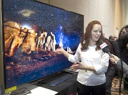 Nitza Martinez shows off an 84-inch Ultra HD LED television by LG Electronics at the opening press event of the Consumer Electronics Show (CES) in Las Vegas. (Reuters) CES, the big gadget show