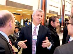 JP Morgan Chase chief executive officer Jamie Dimon (C) talks with other participants during the World Economic Forum annual meeting in Davos. AFP photo 2013 World Economic Forum in Davos