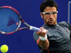 Janko Tipsarevic of Serbia in action against Slovenian Aljaz Beden in their semifinal match at the ATP Chennai Open 2013 in Chennai. PTI/R Senthil Kumar Jan 5: day in pics