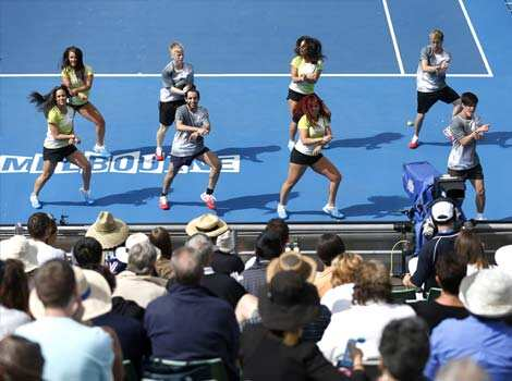 Entertainers perform the Gangnam Style dance on Margaret Court Arena during a break in the first round match between China