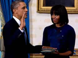 US President Barack Obama takes the oath of office as frst lady Michelle Obama holds a bible during the official swearing-in ceremony at the White House in Washington on January 20, 2013. (REUTERS/Doug Mills/Pool) Jan 20: Day in pics