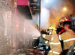 Firefighters try to put out a fire at a nightclub in Santa Maria, Brazil. The fire that tore through the kiss nightclub killed at least 232 people. (AFP Photo) Fatal fire in Brazil