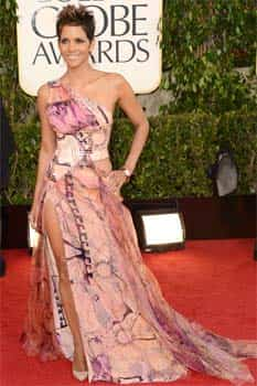 Actress Halle Berry looks hot in a printed gown with a sexy slit on it. (AFP Photo) Style n