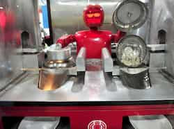 "A robot that specialises in cooking, prepares ""jiaozi"" (Chinese dumplings) at a Robot Restaurant in Harbin. Reuters Photo Robot restaurant"