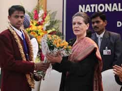 UPA chairperson Sonia Gandhi receives a bouquet from an awardeee as Prime Minister