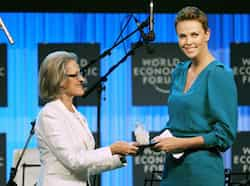 South African actress Charlize Theron receives a World Economic Forum Crystal award from Hilde Schwab, chairperson and co-Founder of the Schwab Foundation for Social Entrepreneurship at the congress center in Davos, prior to the opening of the World Economic Forum. AFP photo 2013 World Economic Forum in Davos