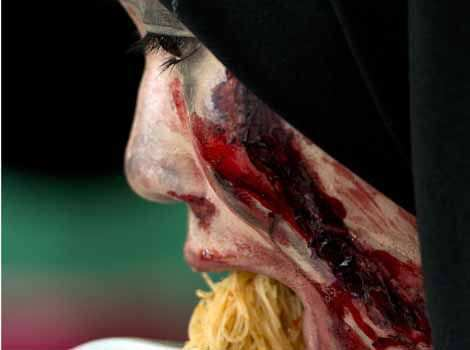 A Malaysian youngster dressed as zombie eats noodles during a zombie run inside a jungle in the outskirts of Kuala Lumpur. AFP Outrunning Zombies