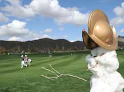 Players walk past a snow man on the second hole during the first round of the World Golf Championships - Accenture Match Play at the Golf Club at Dove Mountain in Marana, Arizona. (AFP) Feb 22: Day in pics