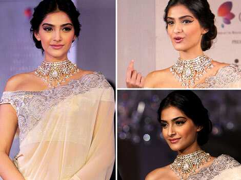 Sonam Kapoor looked radiant in a sari and the heavy ornament as she showcased diamond jewellery during an event of announcing of India