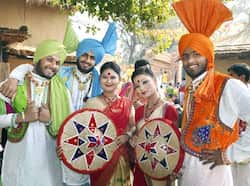 Folk artists pose one for camera during Surajkund International Crafts Mela in Faridabad. Photo: PTI Dancing away at Surajkund