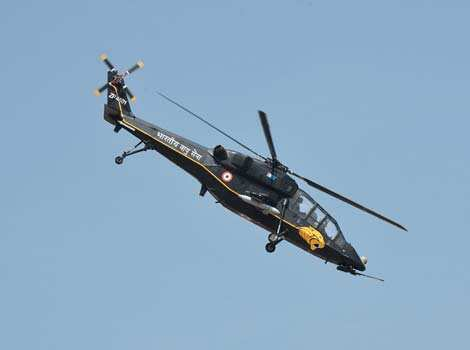 "A HAL ""Black Tiger"" Light Combat Helicopter (LCH), currently under development for the Indian armed forces, performs during Aero India 2013 at the Yelahanka Air Force station in Bangalore. AFP Sky spectacle: Aero India 2013"