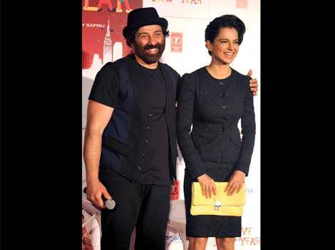 Sunny Deol and Kangna Ranaut share a light moment at a promotional event for her upcoming film I Love New York. (AFP Photo) CLASSY! Kangana Ranaut promotes I Love New Year