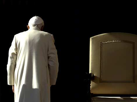 Pope Benedict XVI leaves at the end of his weekly audience in Saint Peter
