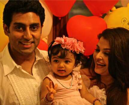 http://www.hindustantimes.com/Images/popup/2012/11/ash-abhi-aaradhya.jpg