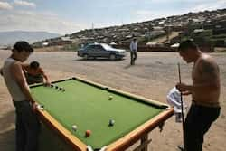Mongolians play billiard at the main road of the Gers district at the Mongolian capital of Ulan Bator July 4, 2006. Reuters/Nir Elias  Travelogue: Mongolia