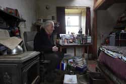 Artist and poet Barry Edgar Pilcher sits in his cottage on the Island of Inishfree in County Donegal. Photo: Reuters/Cathal McNaughton  One man island