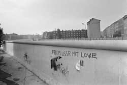 "Picture taken on October 13, 1976 of an inscription ""from USSR mit love"" on the Berlin Wall. The Berlin wall built by the East German government to seal off East Berlin from the part of the city occupied by the three main western powers (USA, Great Britain and France), and to prevent mass illegal emigration to the West.Photo AFP Berlin Wall graffiti"